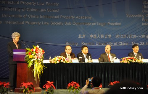 Liu Yang, Exec. VP of the China Law Society, introduces speakers in the first session.  Also visible are Mark Cohen (USPTO), Chong Quan (MOFCOM), David Kappos (USPTO), and Shen De Yong (VP of the Supreme People's Court).
