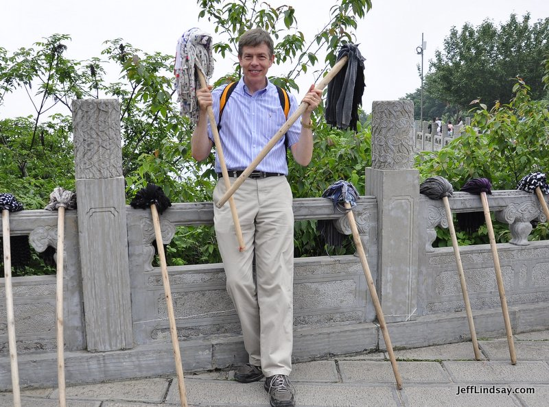 Jeff Lindsay holding two mops