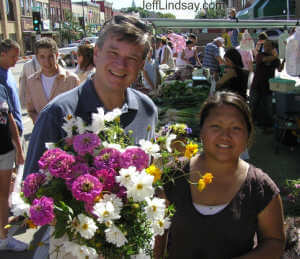 Mayor Timothy Hanna buying flowers at Appleton's Farmers Market, August 6, 2005. Tria is the vendor.