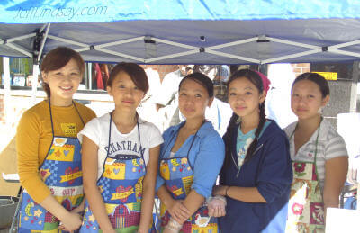 Five Hmong girls at Appleton's Octoberfest, Sept. 25, 2004, working to raise funds for a community group that helps needy families.