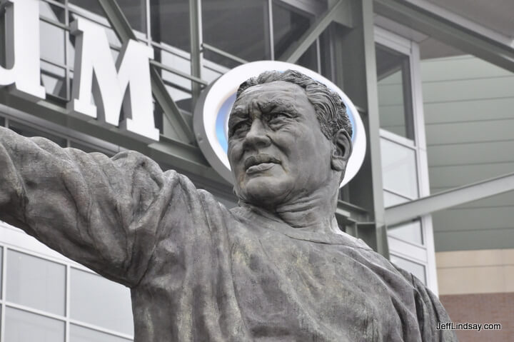 Saint Curly Lambeau, one of football's pattron saints, is honored with this statue in front of Lambeua Field. The halo is couresy of Miller Beer and their oval sign on the stadium itself.