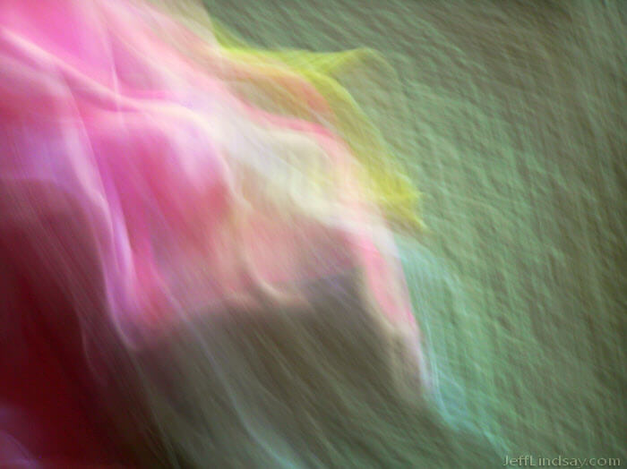 Abstract formed by photographing my niece in pink with a yellow bunny while moving an Olympus C-725 camera rapidly.