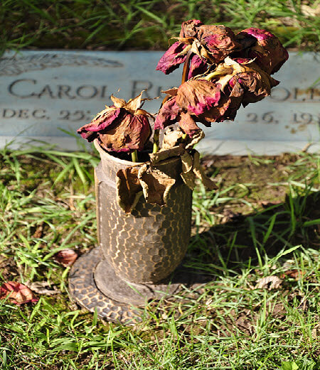 Withered flowers at a tombstone in Appleton, a reminder of the temporary nature of our lives here. Are you focused on what will matter for the long run?