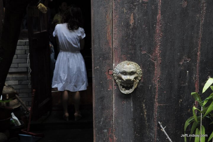 Sinister door knob and potential victim