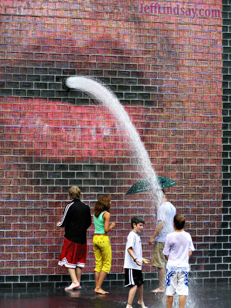 People interacting with the amazing art at Chicago's Millennium Park, Aug. 11, 2005.
