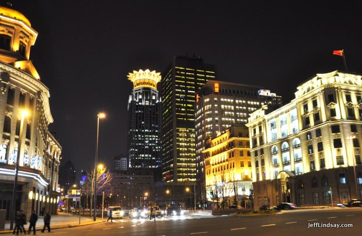 Night view of the Bund showing the famous Bund Center, where I work.