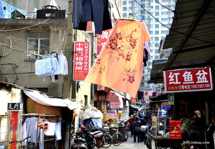 A street scene in the alleys of old Shanghai near Laoximen and the South Bund Fabric Market, March 2012. Shanghai, 2012