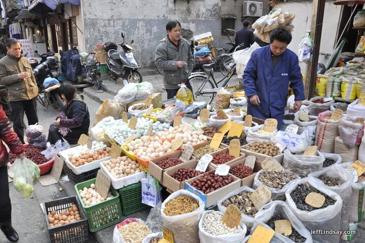 Eggs, dates, seeds, and other dry goods being sold in the old city of Shanghai near the Xiaonanmen. Shanghai, 2012