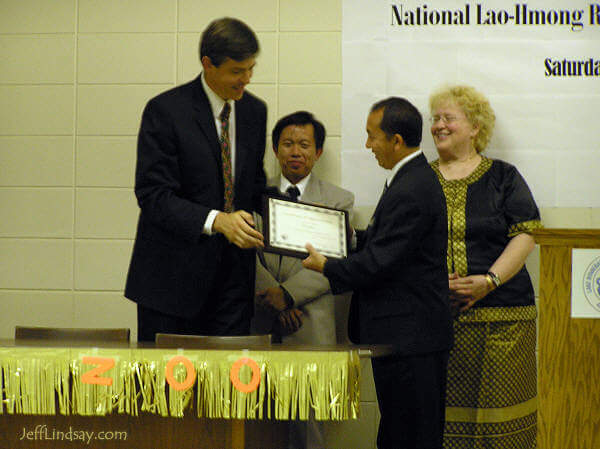 Jeff Lindsay receiving a plaque after his hour-long presentation at the National Lao-Hmong Recognition Day event.