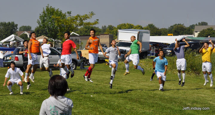 Hmong soccer players flying.