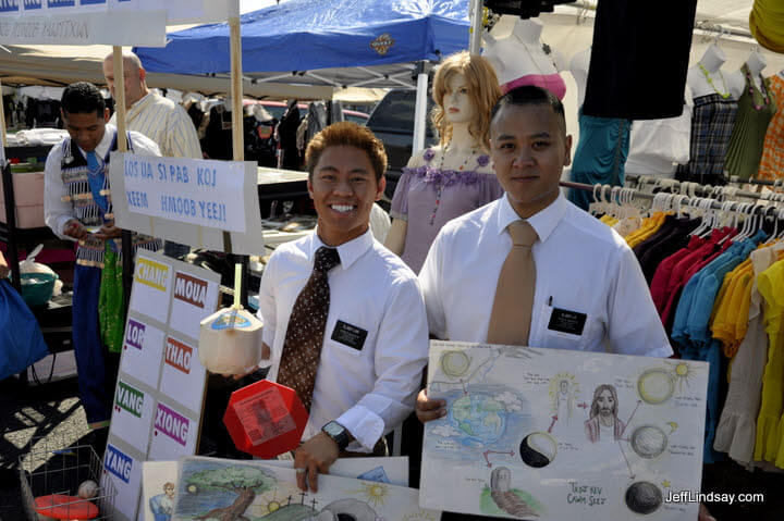 Some Hmong-speaking Mormon missionaries (Latter-day Saiints) at a booth at the Hmong soccer tournament in Oshkosh, 2009.