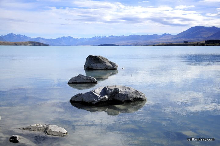 New Zealand: three rocks in a lake