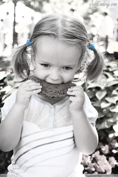 My granddaughter enjoying a cookie at a farmer's market in Wisconsin.
