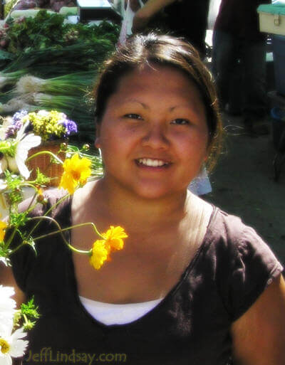 Tria, a Hmong girl at a farmers' market in Appleton, Aug. 2005.