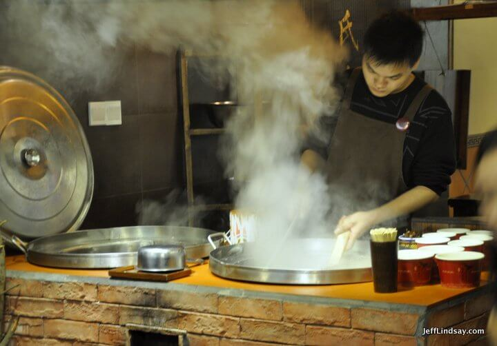Xiamen, Fujian China, April 2013: steam from a noodle vat